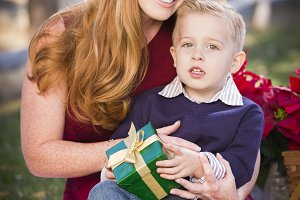 Young Boy Holding Christmas Gift wit