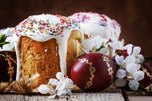 Easter cake and red painted eggs, wh