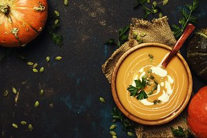 Cream pumpkin soup in a wooden bowl,