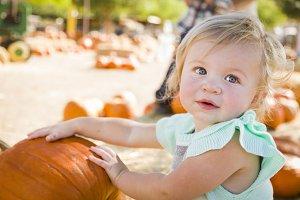 Adorable Baby Girl Having Fun at the