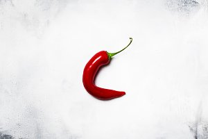 Red hot chili pepper on a gray backg