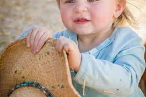 Adorable Baby Girl with Cowboy Hat a