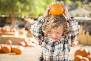 Little Boy Holding His Pumpkin at a