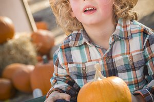 Little Boy in Cowboy Hat at Pumpkin