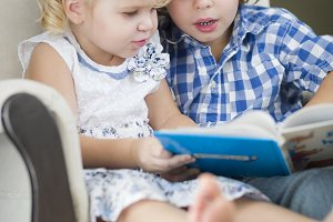 Young Brother and Sister Reading a B