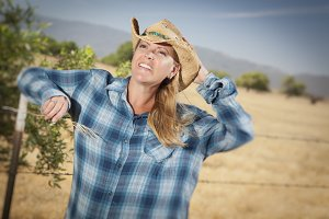 Beautiful Cowgirl Against Wire Fence