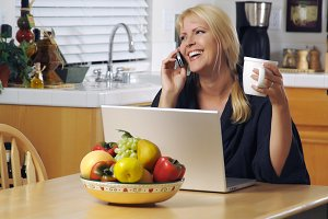 Woman in Kitchen on Cell Phone & Lap