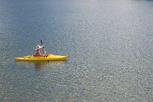 Woman Kayaking on Beautiful Mountain