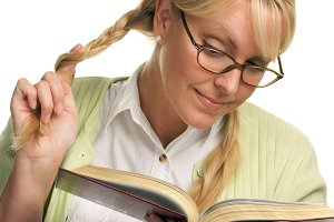 Female With Ponytails Reads Her Book