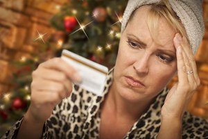 Upset Woman Holding Credit Card In F