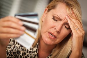 Upset Woman Holding Her Many Credit