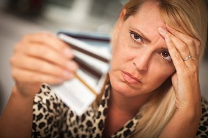 Upset Woman Glaring At Her Many Cred