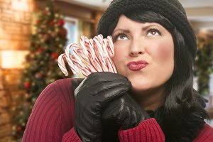 Woman Holding Candy Canes in Christm