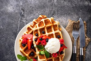 Belgium waffles with berries and ice