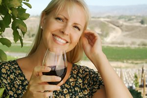 Attractive Woman Sips Wine