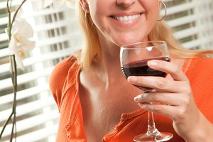 Attractive Blond with a Glass of Win