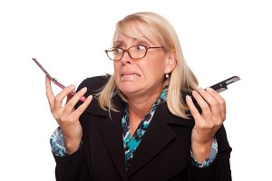 Frustrated Woman with Two Cell Phone