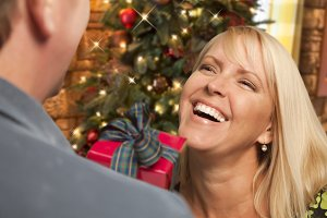Girl Exchanging Gift At Christmas Pa