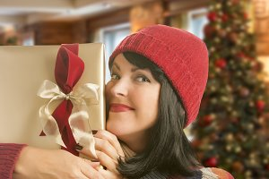 Woman Holding Wrapped Gift in Christ