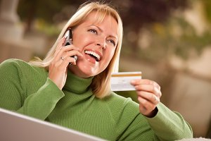 Cheerful Woman on Phone and Laptop w