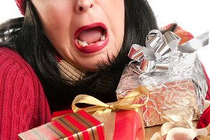Excited Woman Balancing Holiday Gift