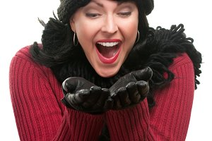 Excited Woman In Winter Clothes Hold