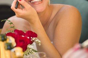 Blonde Woman Applies Makeup at Mirro