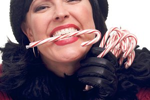Attractive Woman Holds Candy Canes