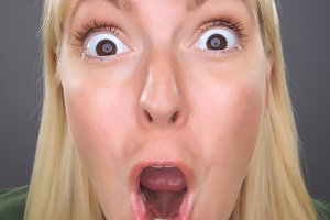 Shocked Blond Woman with Funny Face