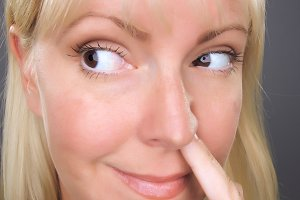 Blond Woman with Finger in Her Nose