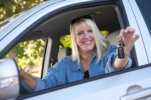 Attractive Woman In New Car with Key