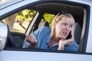 Concerned Woman Using Cell Phone Whi