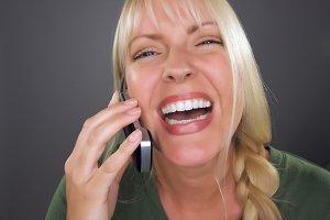 Joyful Blond Woman Using Cell Phone