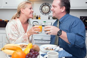 Happy Attractive Couple In Kitchen