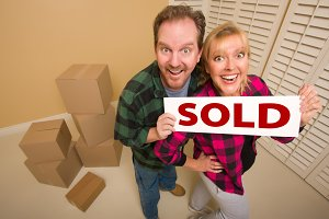 Goofy Couple Holding Sold Sign Surro