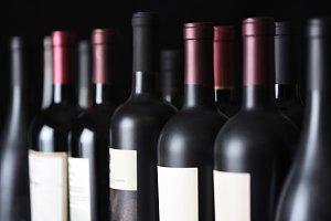 Row of vintage wine bottles