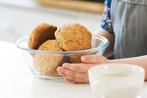 Little girl holds homemade cookies