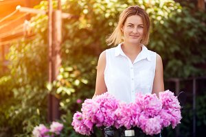 Woman with peonies