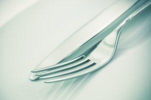 Fork and knife on a white background