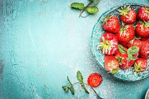 Strawberries with mint leaves
