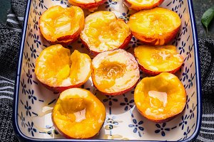 Baking dish with peaches  and honey