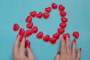 Decorative hearts and female hands o