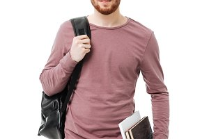 Handsome male student carrying books