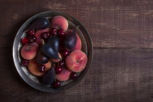 Fruits on the dark wooden table. Top