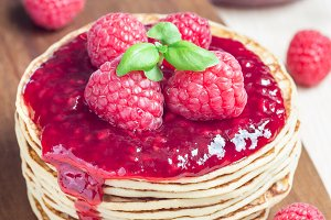 Stack of pancakes or fritters with r