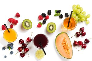 Above view of fruits, berries and ju