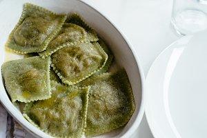 Close up of green raviolis on table
