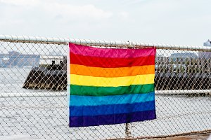Rainbow flag for LGBT pride in fence