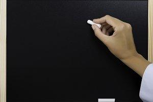 hand writing on a blackboard