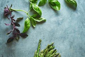 food background. asparagus and basil